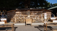 Rows of wooden wishing plates written by visitors